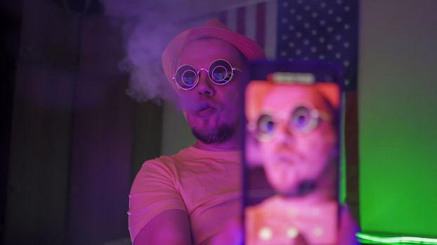 Smoker Of Hookah Makes Selfie In Neon Backlit