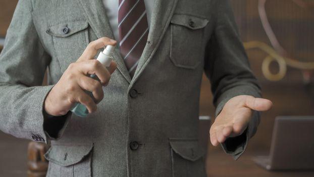 Successful Man Sprinkles Antiseptic Spray On Hand