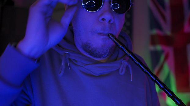 British Man Smokes Hookah In Neon Backlight