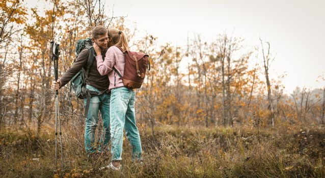 Traveling Couple Stopped To Relax In A Forest Glade