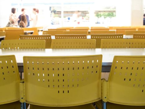 Empty tables and chairs that nobody sit in the cafeteria