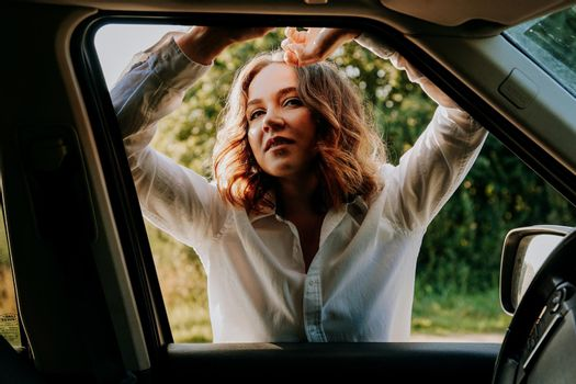 Woman in the car window. Trips and travels out of town. Travel and joy concept