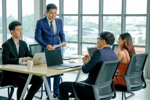 Group of Asian business teamwork discuss during meeting for business work in the room.