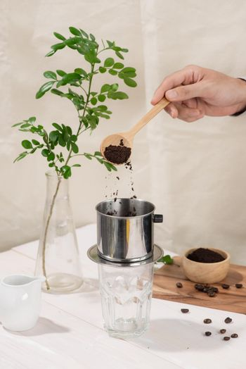 Coffee dripping in vietnamese style on wooden table