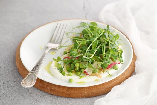 vegan healthy salad made of microgreen sprouts peas