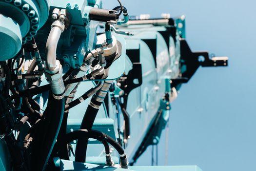 Hydraulic crane engine.The control system of the crane engine.Lifting hydraulic Department on the truck crane.The hydraulic system of the engine.hydraulic hoses on the crane.autoparts