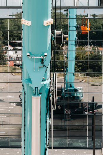 Hydraulic cylinder of the lifting system on a car crane.The control system of the crane engine.Lifting the hydraulic compartment on a truck crane.