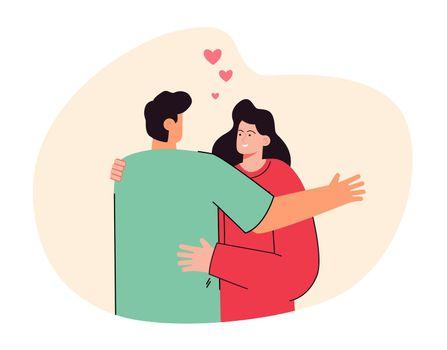 Back view of boyfriend hugging girlfriend