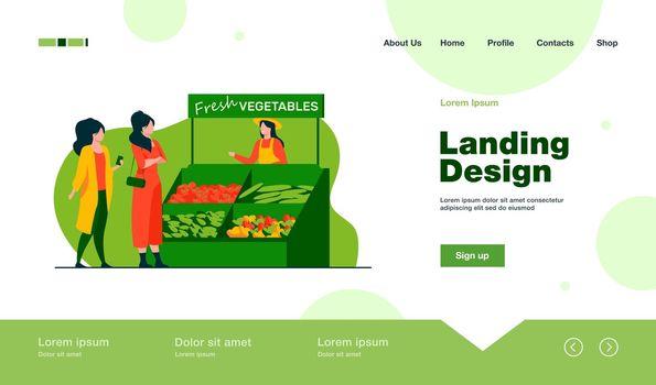 Women choosing fresh vegetables from farm