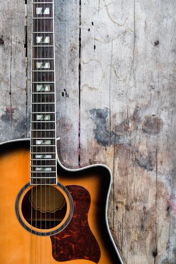 Acoustic Guitar on a wood background