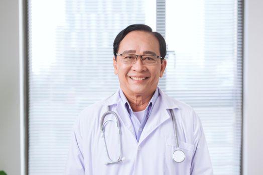 Portrait of senior doctor in medical office