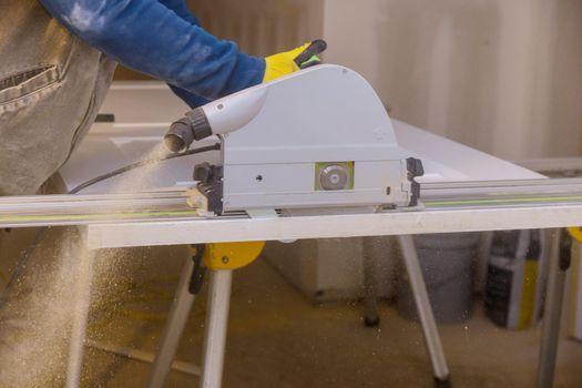 Close Up process cutting of hand circular saw at wood door cuts