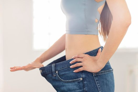 Young woman in jeans large size .Weight Loss concepts