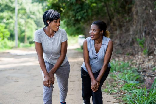 two young woman doing outdoor exercise