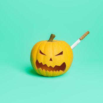 halloween pumpkin with a knife stuck in it