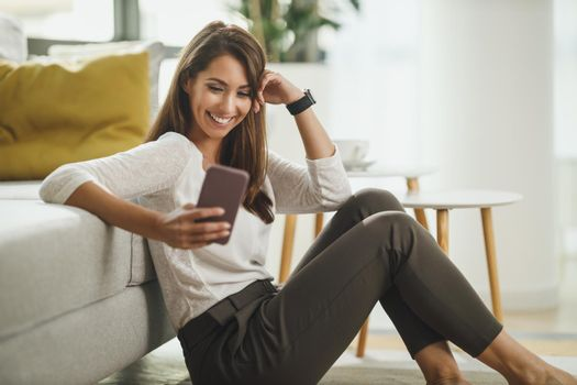Woman Typing A Text Message