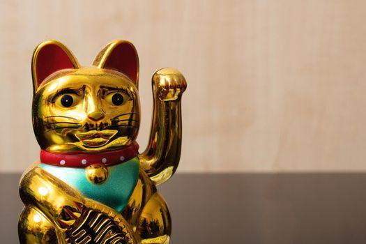 Maneki neko cat closeup, japan lucky charm