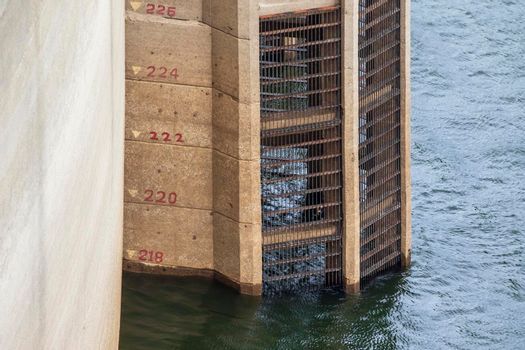 The bars that look at the water level and provide a way to flow into the electricity production of Bhumibol Dam in Tak Province, Thailand.