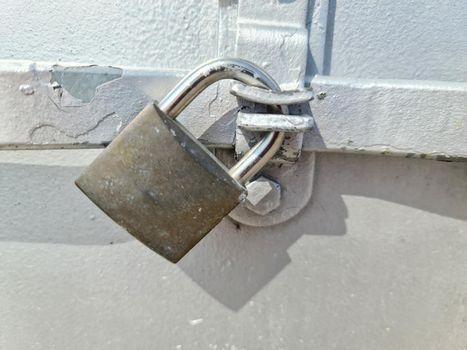 Close uo of a lock at a close metal door