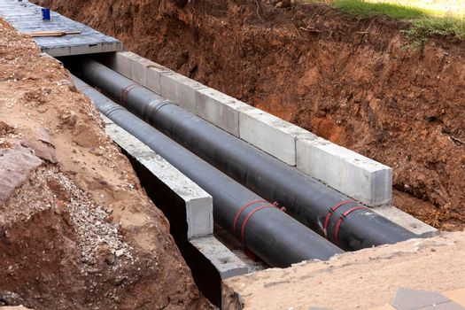 Insulated pipes in the trench. Water main reconstruction and replacement.