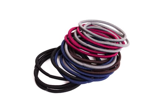 Pile of hair ties isolated on white background