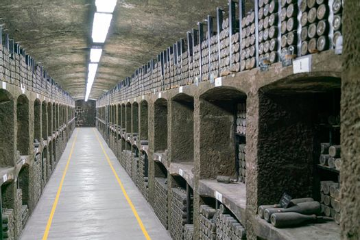 collections of old wine bottles in wine cellars