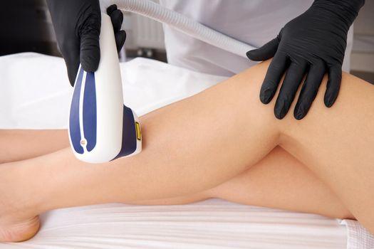 Laser hair removal on ladies legs in beauty salon