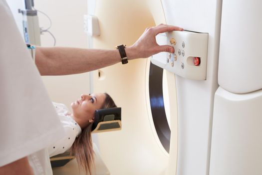 Female patient undergoing MRI - Magnetic resonance imaging in Hospital. Medical Equipment and Health Care concept