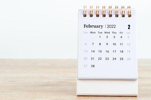 February calendar 2022 on wooden table.