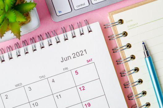 June 2021 calendar with note book.