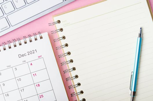 December 2021 calendar with note book.