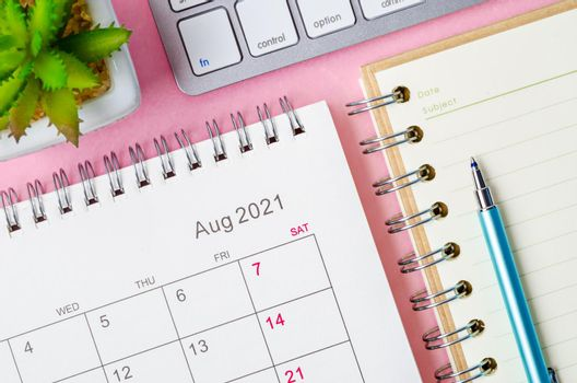 August 2021 calendar with note book.