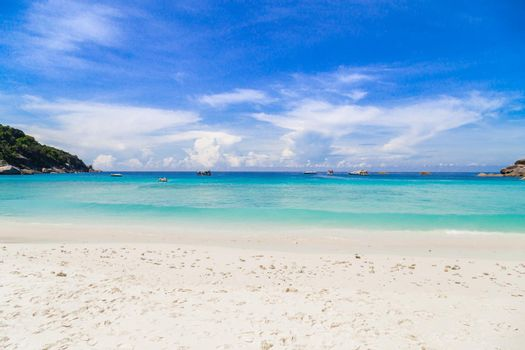 Beautiful sandy beach with wave at Similan Islands.