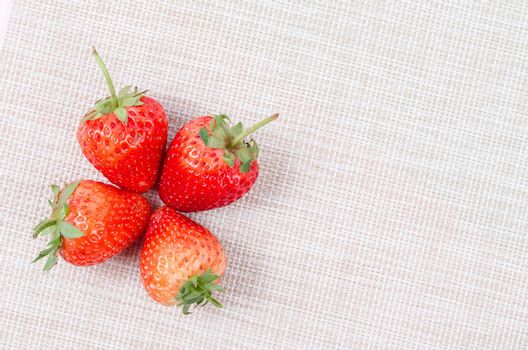 The freshness strawberries on tablecloth.