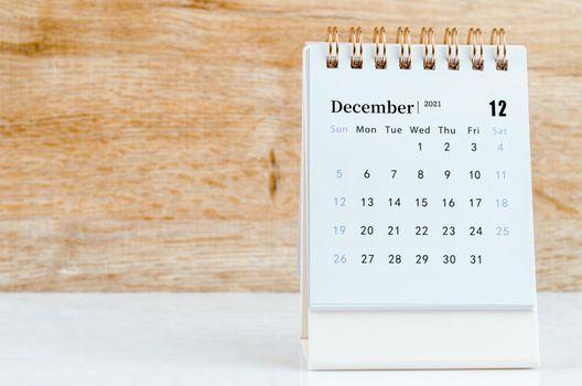 December Calendar 2021 on wooden table.