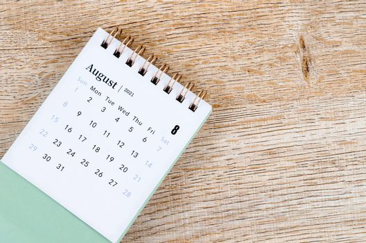 August Calendar 2021 on wooden table.