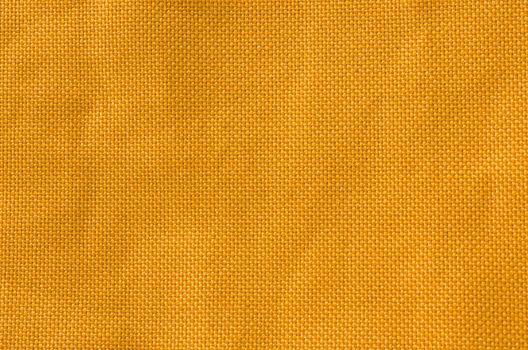 Yello cloth texture background.