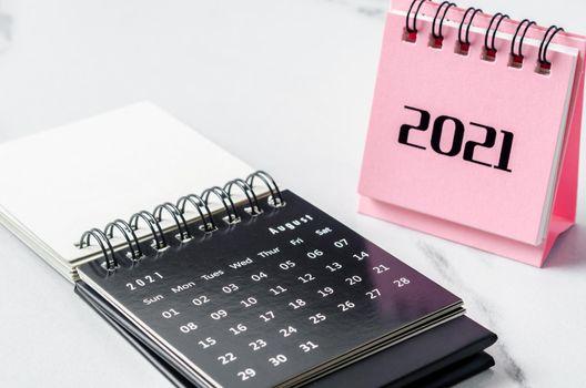 mini calendar August 2021 on the table.