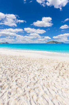 Beautiful sandy beach with wave crashing on sandy shore at Similan Island, Thailand