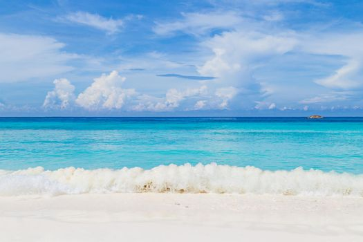 Beautiful sandy beach with wave at Similan Islands, Thailand.