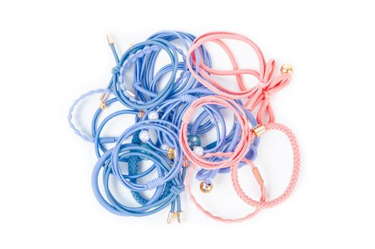 Heap of colorful fabric rubber bands. Elastic hair ties in vibrant colors.