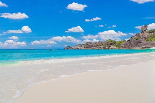 Beautiful sandy beach with wave crashing on sandy shore at Similan Islands.