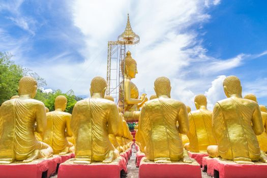Row of disciple statues surrounding big buddha statue in public to the general public worship worship of, Thailand.