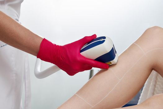 Woman in professional beauty clinic during laser hair removal