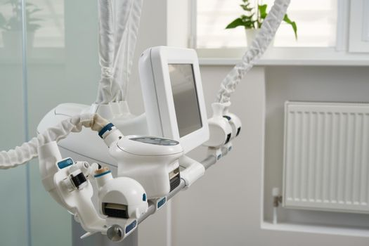 Light interior of modern aesthetic cosmetolody clinic with lpg equipment for cosmetic procedures