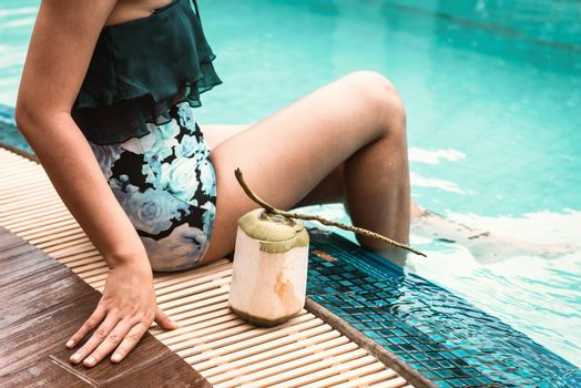 Close-Up of Sexy Woman in Swimsuit Relaxing in Swimming Pool, Beautiful Woman  Relax on The Edge of Poolside at Resort Hotel. Summer Vacation and Holiday Relaxation Lifestyles