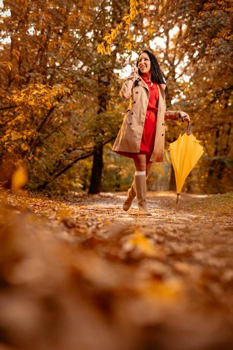 Phoning In Autumn Park