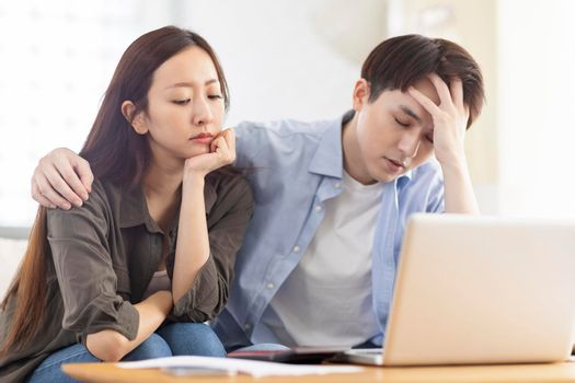 Upset couple frustrated troubled with paying bills expenditures.