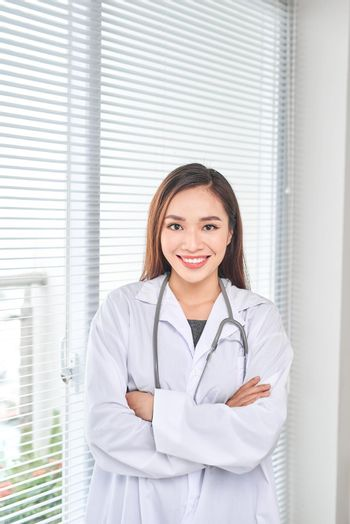 Portrait of smiling female doctor standing posing in her hospital office., Healthcare and medical occupation concept.