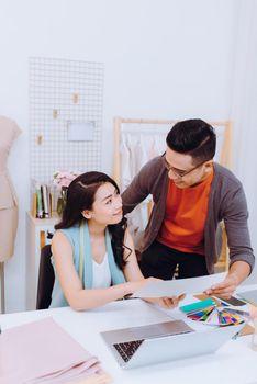 Fashion designers working on creation in workshop